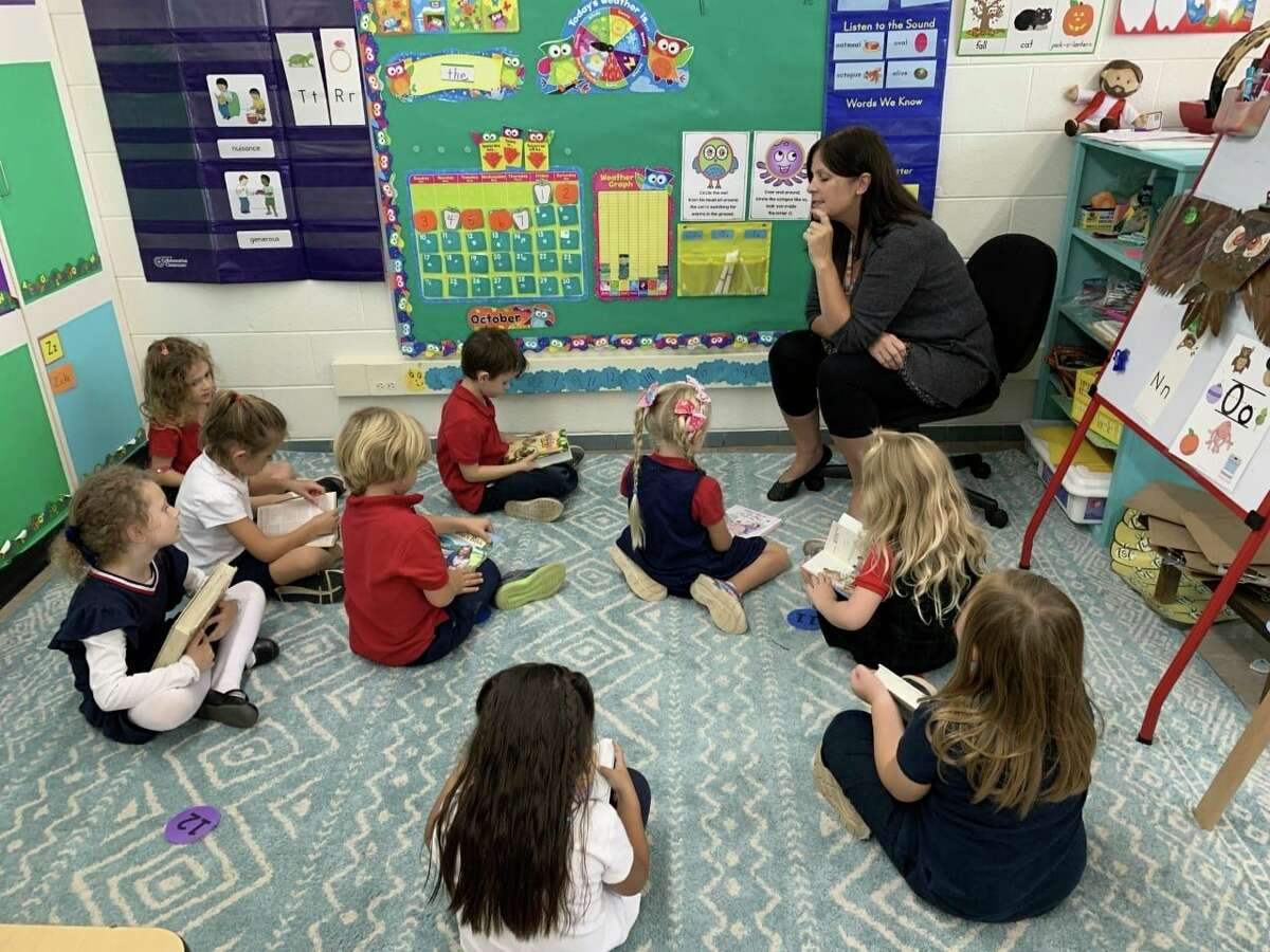 Manistee Catholic Central students inShelly Connell's kindergarten class enjoy National Bring Your Bible to School Day. (Courtesy photo)