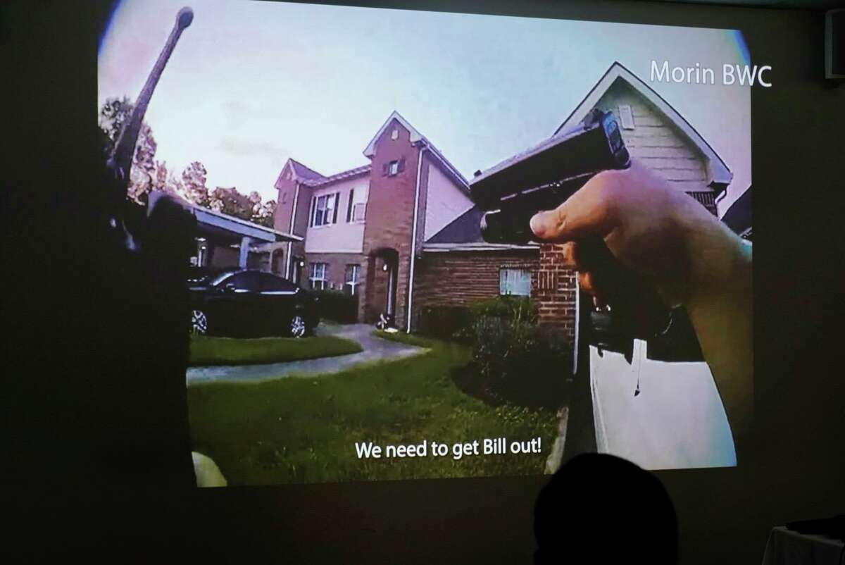 Body-worn camera footage from the fatal shooting on Sept. 20 of officer William Jeffrey is played on screens during a media briefing at the Houston Police Department headquarters in downtown Houston, Oct. 12, 2021.