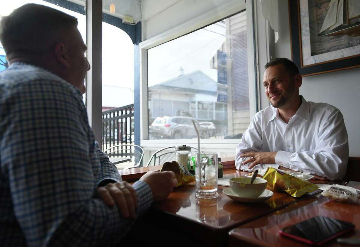 Friends John Bell, left, of Middletown and Eric Lane of Clinton enjoy lunch at the newly reopened The Coffee Break diner in Clinton.