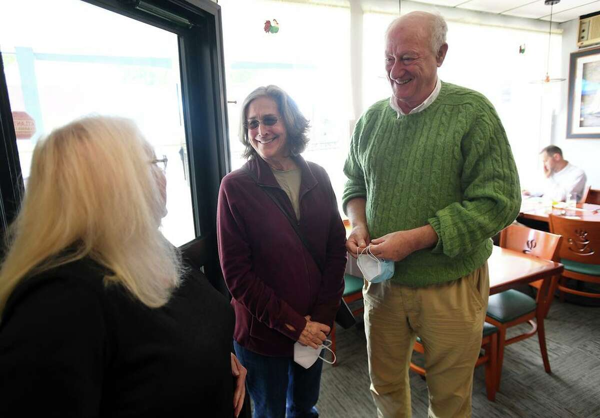 Owner Donna Uricchio, left, welcomes back longtime customers Madora and Tom Koehne of Old Lyme to The Coffee Break diner in Clinton. Madora said she was heartbroken when the business closed during the pandemic.