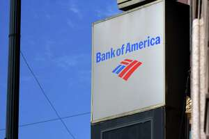 Bank of America branch and offices on State Street on Tuesday, Oct. 12, 2021, in Albany, N.Y. Bank of America is increasing its hourly wage for workers.