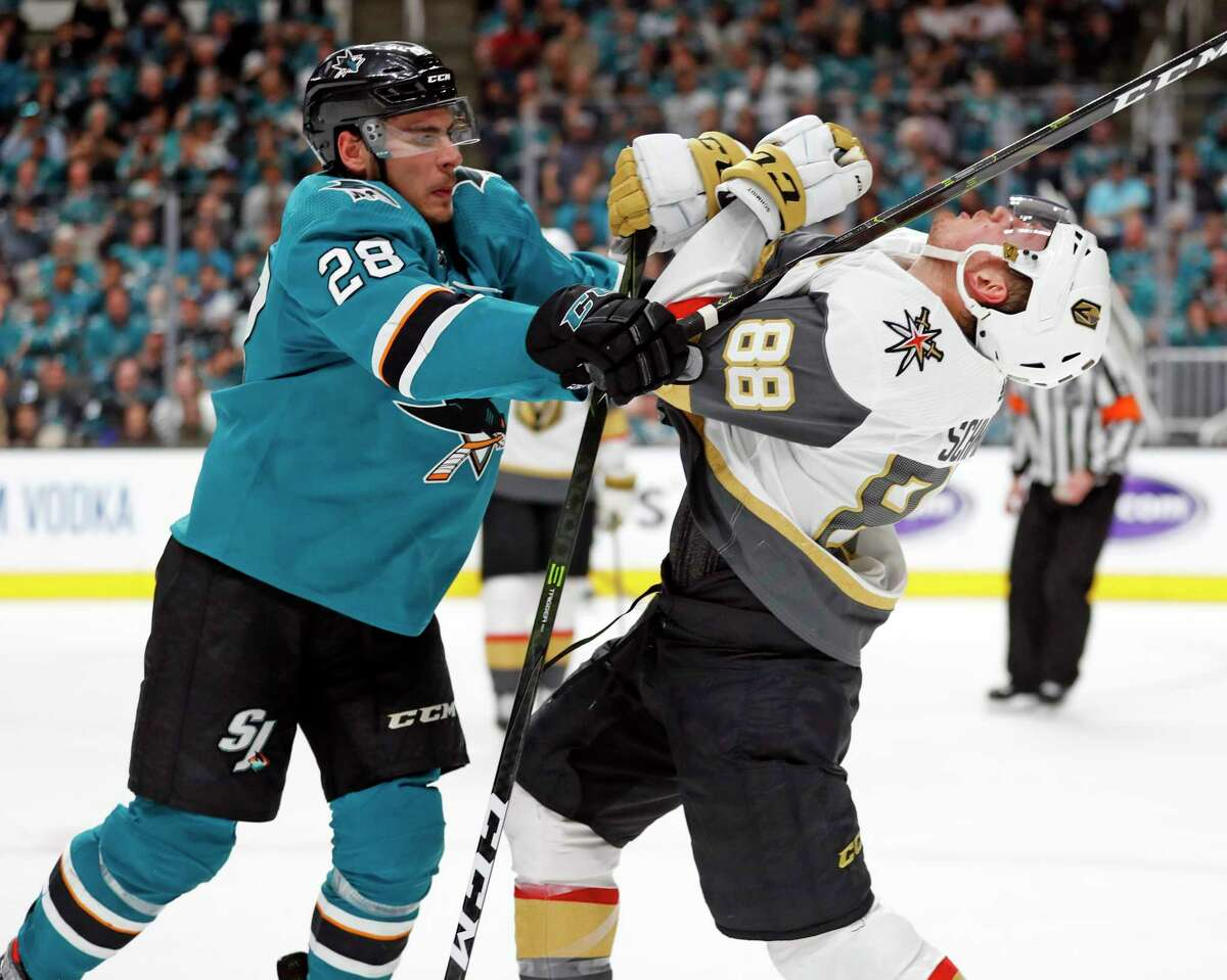 San Jose Sharks player Timo Meier (left) hits the Vegas Golden Knights' Nate Schmidt during Game 7 of the 2019 NHL Western Conference first-round playoffs at SAP Center in San Jose.