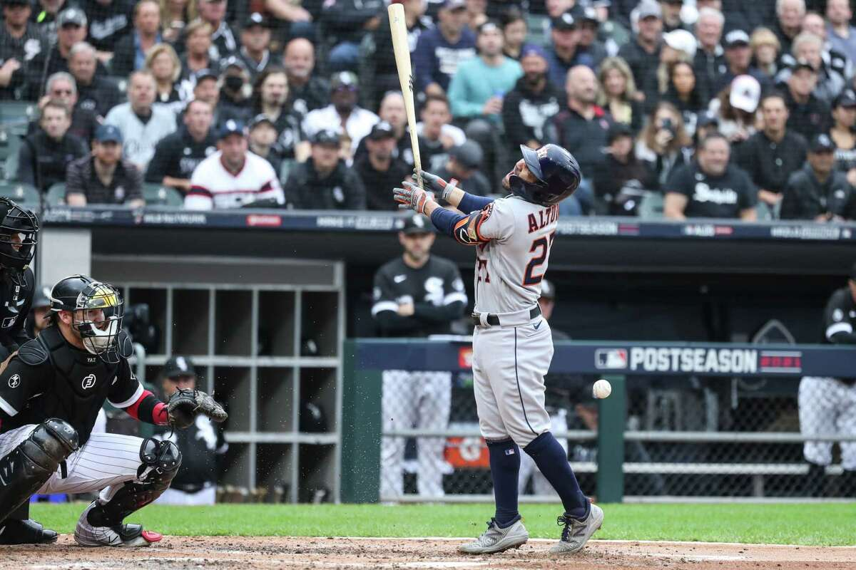 Houston Astros second baseman Jose Altuve (27) is hit by a pitch from Chicago White Sox starting pitcher Carlos Rodon during the third inning in Game 4 of the American League Division Series Tuesday, Oct. 12, 2021, in Chicago.