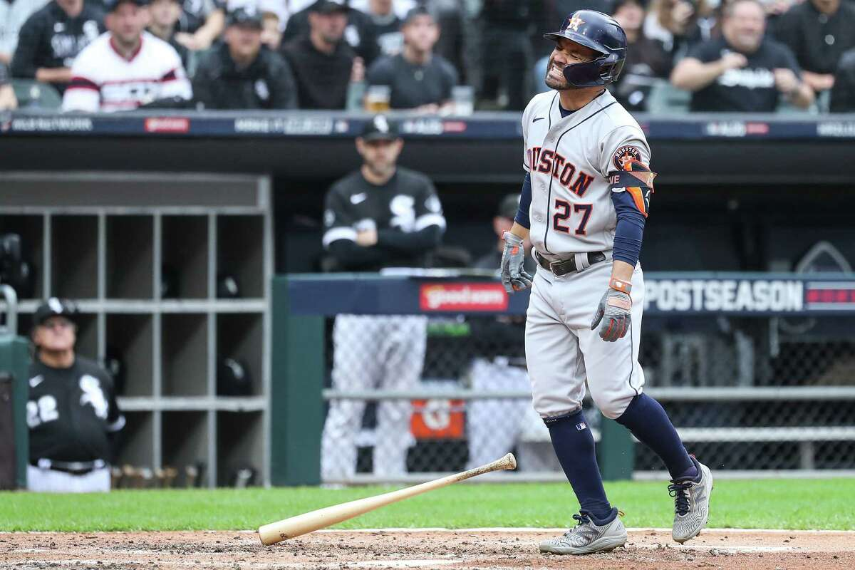 Houston Astros second baseman Jose Altuve (27) reacts after being hit by a pitch from Chicago White Sox starting pitcher Carlos Rodon during the third inning in Game 4 of the American League Division Series Tuesday, Oct. 12, 2021, in Chicago.