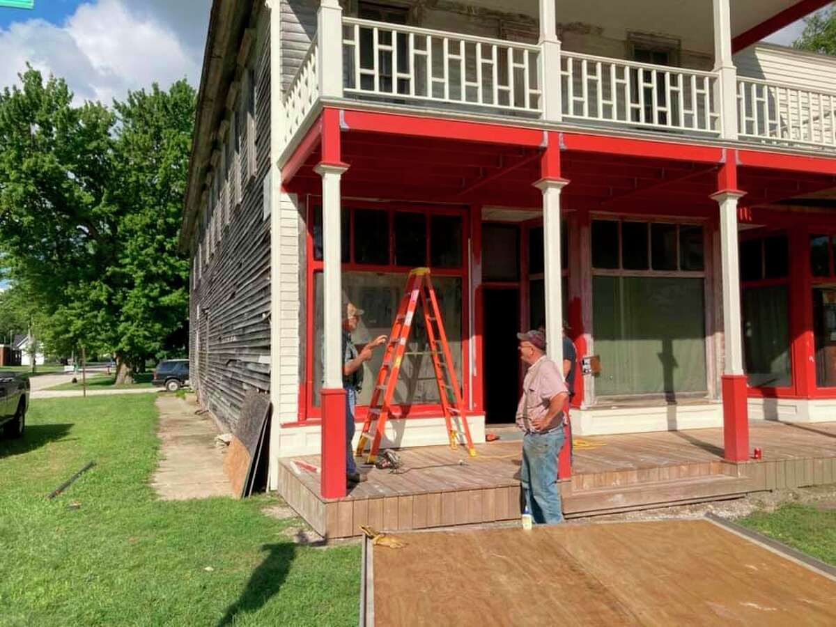 Workers help restore the front of the Kilmanagh Store back in September, with restoration work going on for the past four years. Tim Voss, the man behind the restoration efforts, has funded and done most of the work himself. (Tim Voss/Courtesy Photo)