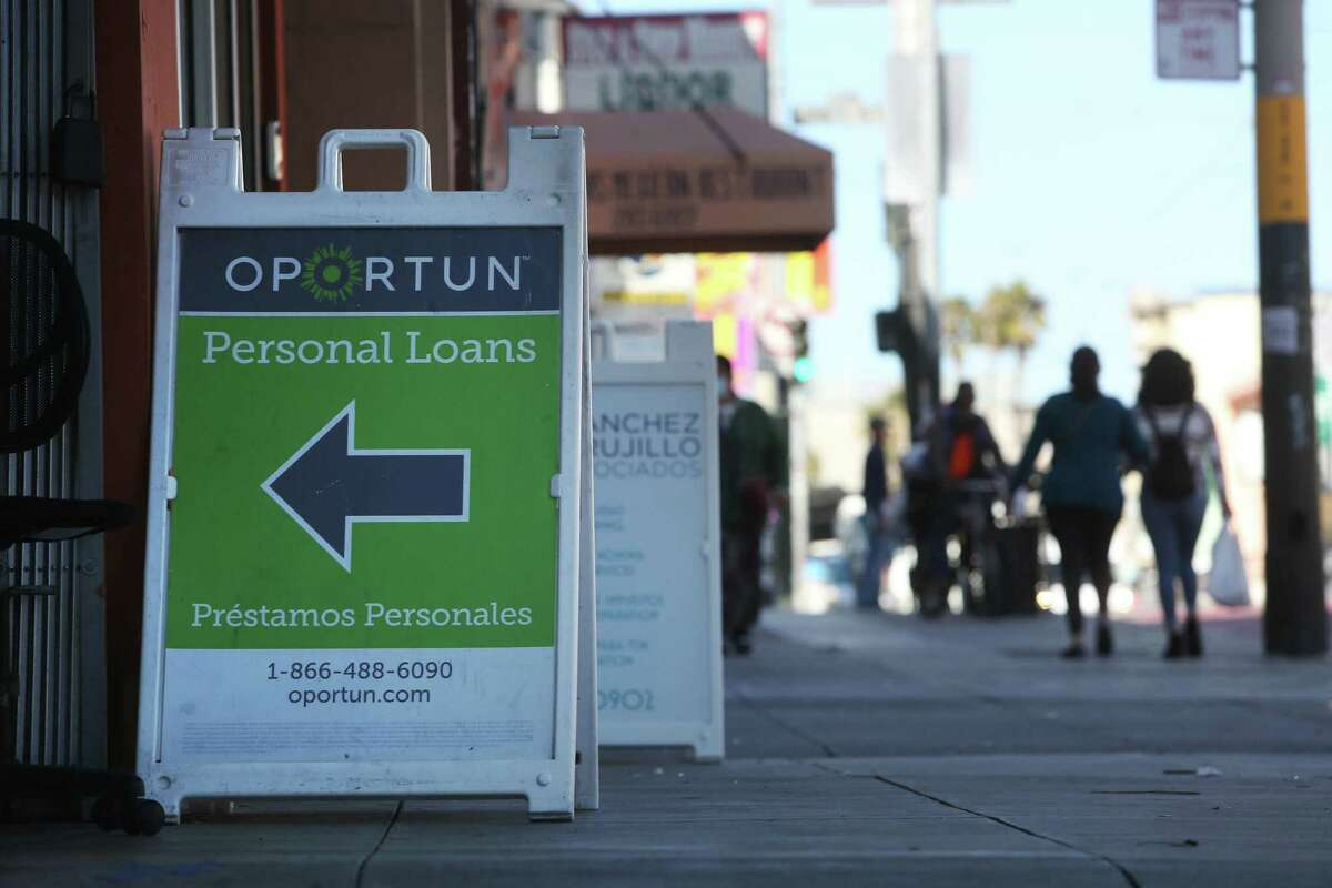 Signage for Oportun outside its office at 3038 Mission St. in San Francisco. The lending company recently withdrew its bid to become a national bank, but signaled that it will try again despite a federal investigation into its collection practices.