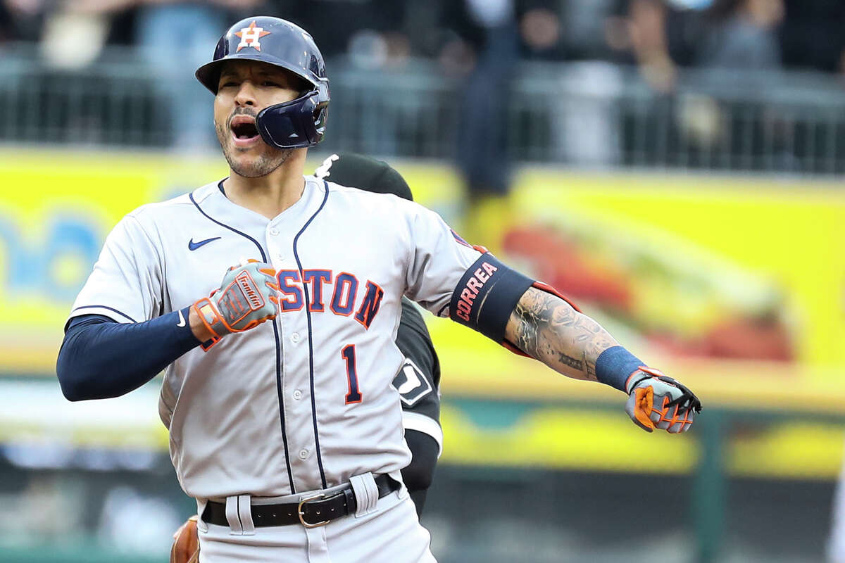 Houston Astros shortstop Carlos Correa reacts after hitting a 2-run double off Chicago White Sox starting pitcher Carlos Rodon during the third inning in Game 4 of the American League Division Series Tuesday, Oct. 12, 2021, in Chicago. Jose Altuve and Alex Bregman scored on the play.