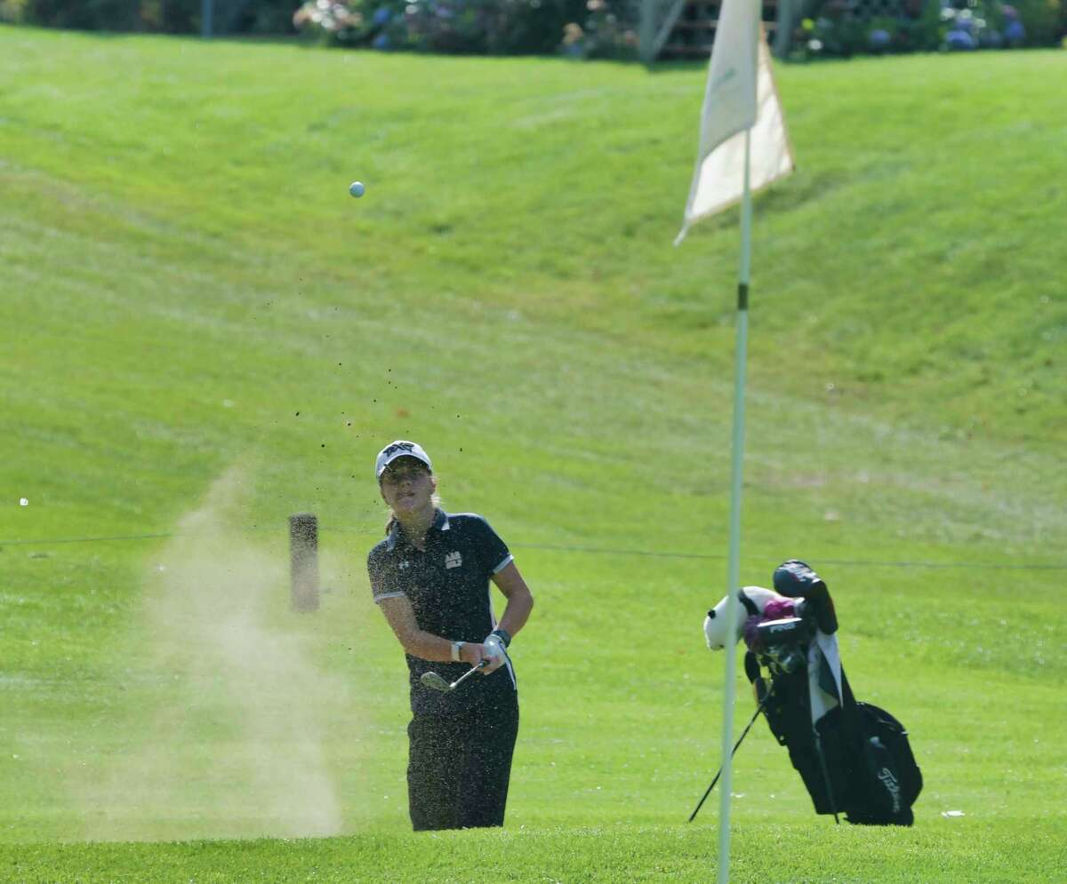 Kennedy Swedick of the Albany Academy for Girls hits out of a sand trap on the 9th hole during the final round of the Section II girls' golf sectionals at the McGregor Links Country Club on Tuesday, Oct. 12, 2021, in Wilton, N.Y.