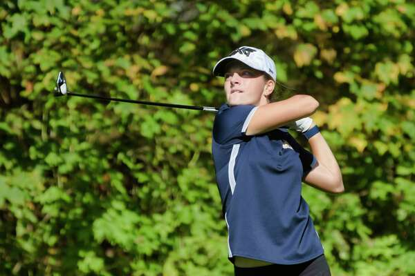Kennedy Swedick of the Albany Academy for Girls hits a tee shot on the 14th hole during the final round of the Section II girls' golf sectionals at the McGregor Links Country Club on Tuesday, Oct. 12, 2021, in Wilton, N.Y.