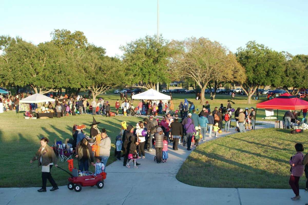 Families enjoy walking the Trick or Treat Trail in Pearland.