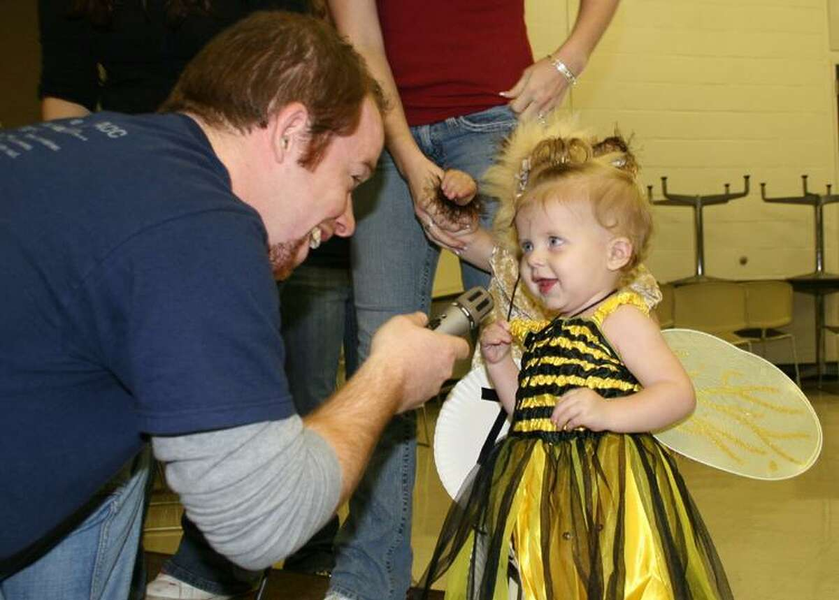 Roy Maxton talks with Lily Beth Raymond of Alvin during the costume contest at a previous Fall Festival at Alvin Community College. This year, the 45th annual event will be from 5-9 p.m. Saturday, Oct. 30 on the ACC campus, 3110 Mustang Road.