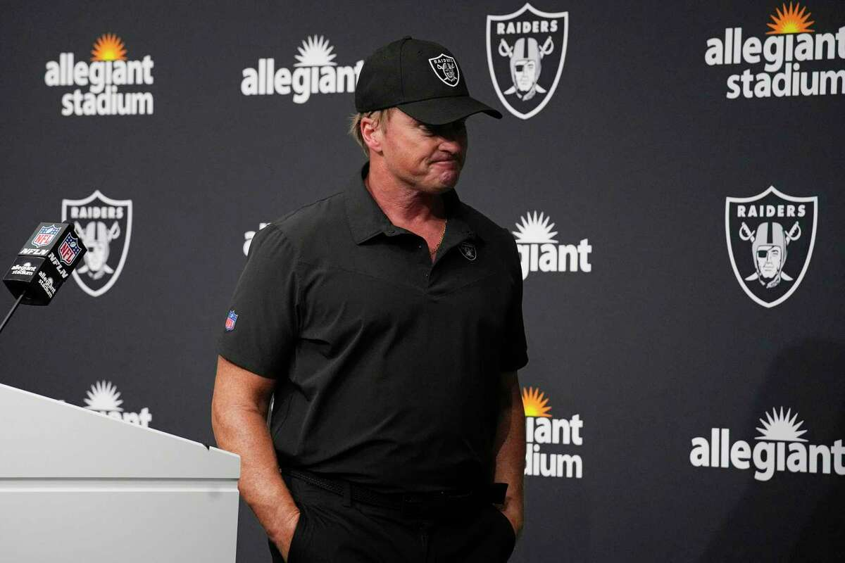 Las Vegas Raiders head coach Jon Gruden leaves after speaking during a news conference after Sunday's loss to Chicago. Gruden resigned Monday night.