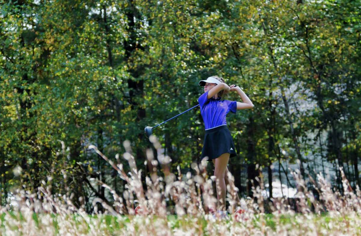 Lillie Junco of Voorheesville hits a tee shot on the 12th hole during the final round of the Section II girls' golf sectionals at the McGregor Links Country Club on Tuesday, Oct. 12, 2021, in Wilton, N.Y.