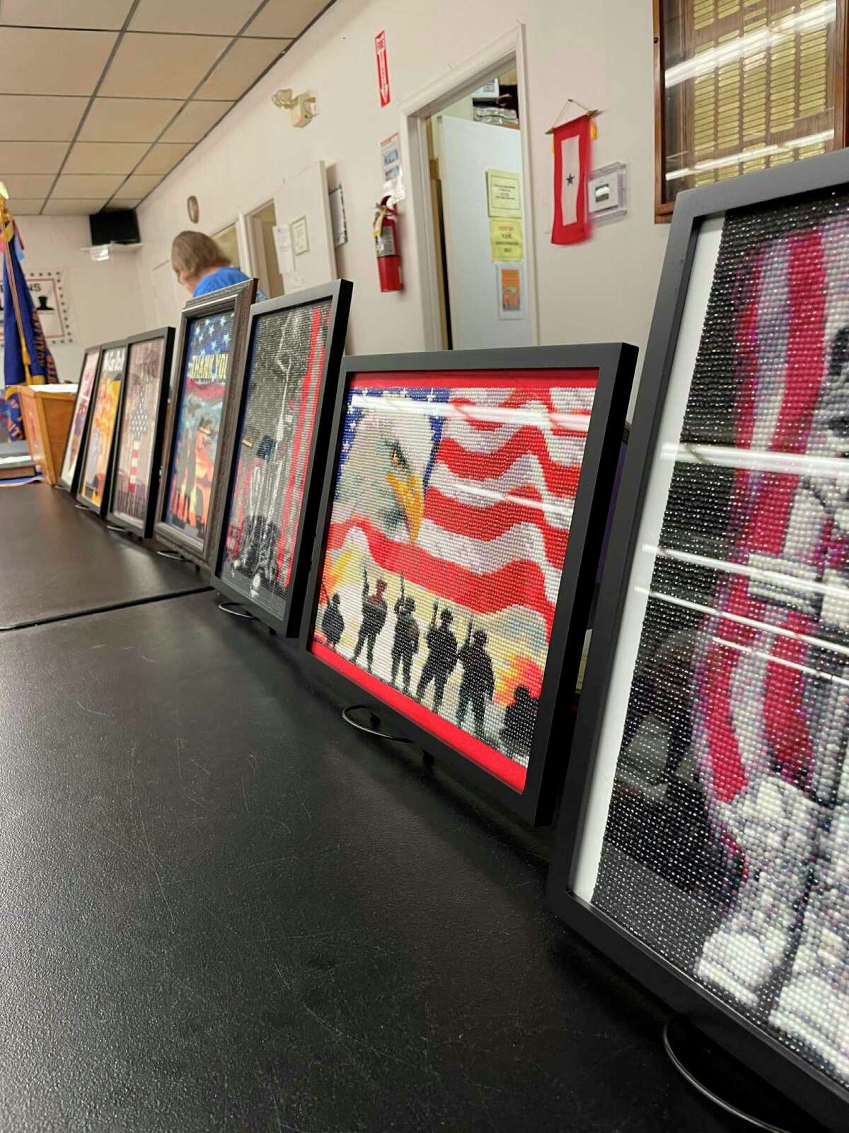 Marjean Nickerson donated 8 individually made 'diamond art' pieces each with military significance to the Mecosta County Veterans of Foreign Wars organization, where several veterans came to view her work. (Pioneer photo/Olivia Fellows)