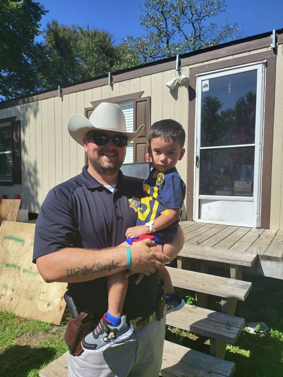 The Grimes County Sheriff's Office honored 3-year-old Christopher Ramirez Monday with the junior deputy badge for surviving three days after he vanished in the woods in Planterville, Texas.