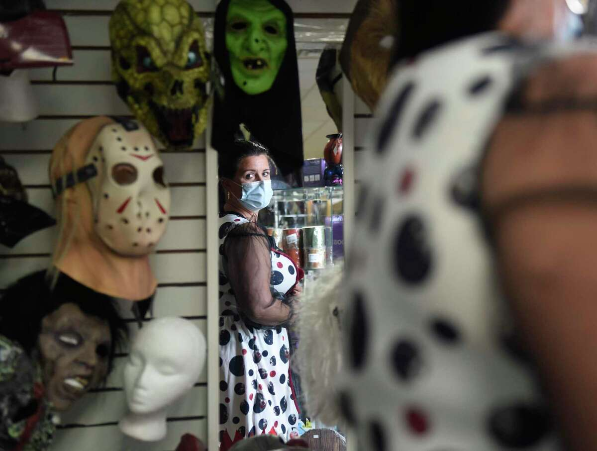 Darien's Marjorie Mason tries on a scary clown costume at Spooky Town in Stamford on Monday. With Halloween quickly approaching, Spooky Town and other costume stores have been busy selling costumes and decorations.