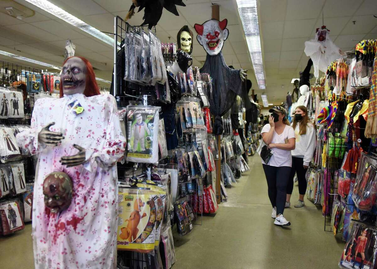 Stamford's Wendy Varnit and her daughter, Payton, 13, browse costumes at Spooky Town in Stamford.