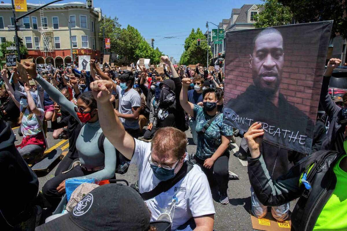 Thousands protest outside the Mission Police Station on June 6, 2020, in San Francisco after the police killing in Minneapolis of George Floyd. Journalists in California will be allowed to cover protests without police interference under a new law signed by Gov. Gavin Newsom.