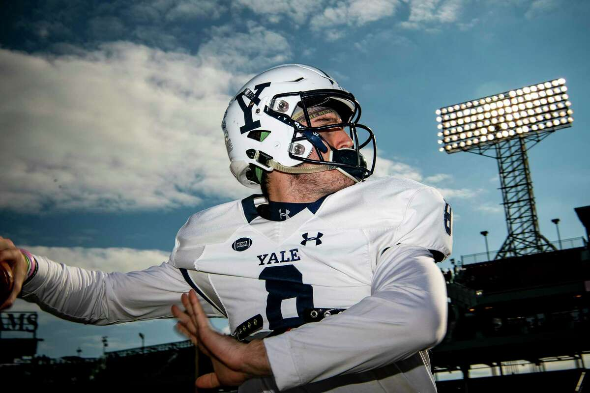 Yale's Patrick Conte warms up before a 2018 game against Harvard at Fenway Park in Boston.