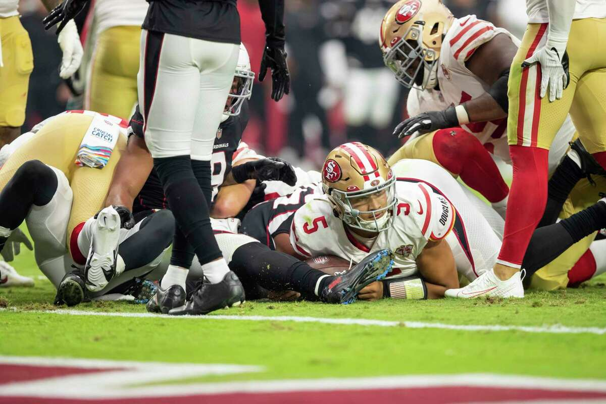 Quarterback (5) Trey Lance of the San Francisco 49ers lays on the ground after being tackled by the Arizona Cardinals in an NFL football game, Sunday, Oct. 10, 2021, in Glendale, Ariz. The Cardinals defeated the 49ers 17-10. (AP Photo/Jeff Lewis)