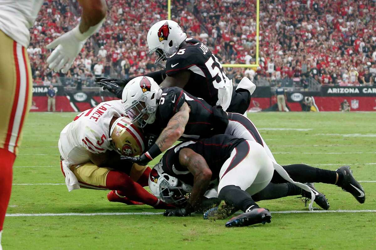 San Francisco 49ers quarterback Trey Lance (5) is stopped short of the goal line on fourth down as he is hit by Arizona Cardinals linebacker Tanner Vallejo (51) during the first half of an NFL football game, Sunday, Oct. 10, 2021, in Glendale, Ariz. (AP Photo/Ralph Freso)