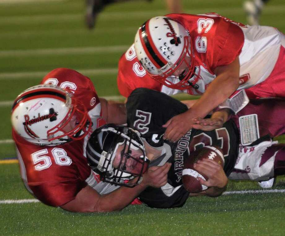 High school football -- Mechanicville's Sam Chase, left, and teammate Chris Hatalsky, right, sack Stillwater's Dan Palmieri in the first half of their game. (Hans Pennink/Special to the Times Union) Photo: Hans Pennink / 00005548A