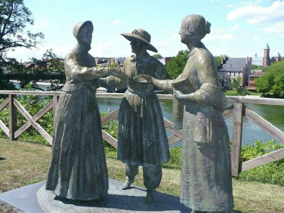 """When Anthony Met Stanton,"" a life sized bronze statue in Seneca Falls, depicting Amelia Bloomer (wearing bloomers, the outfit she developed)  introducing Susan B. Anthony to Elizabeth Cady Stanton in May 1851 in Seneca Falls. (Michael Schuman)"