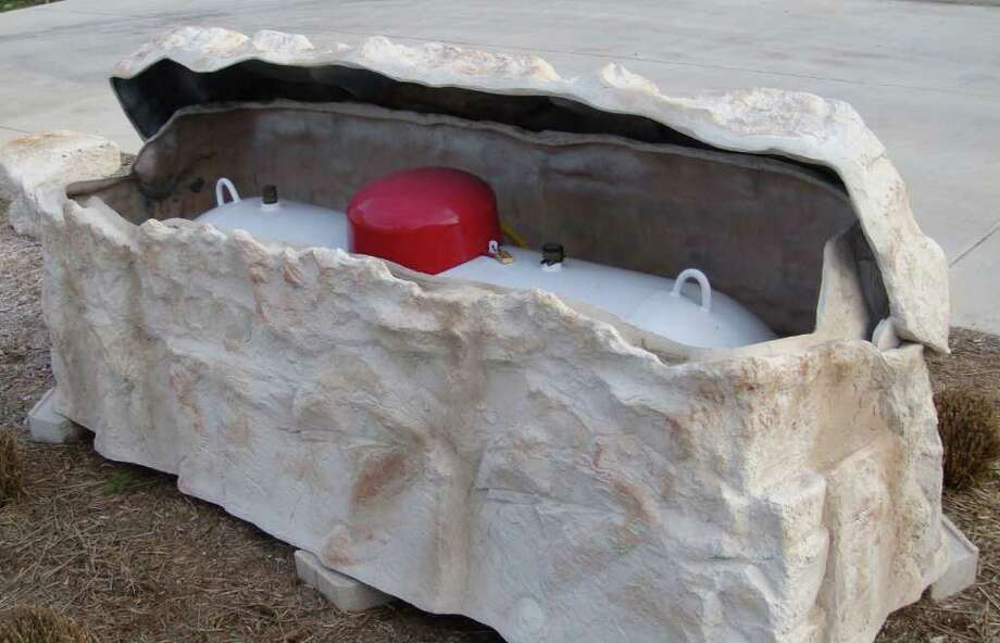 Now a Texas company, appropriately named Boulder Looks, is marketing a propane tank cover shaped like a rock. The 325-pound cover has a hinged lid for easy access and costs $1,899.