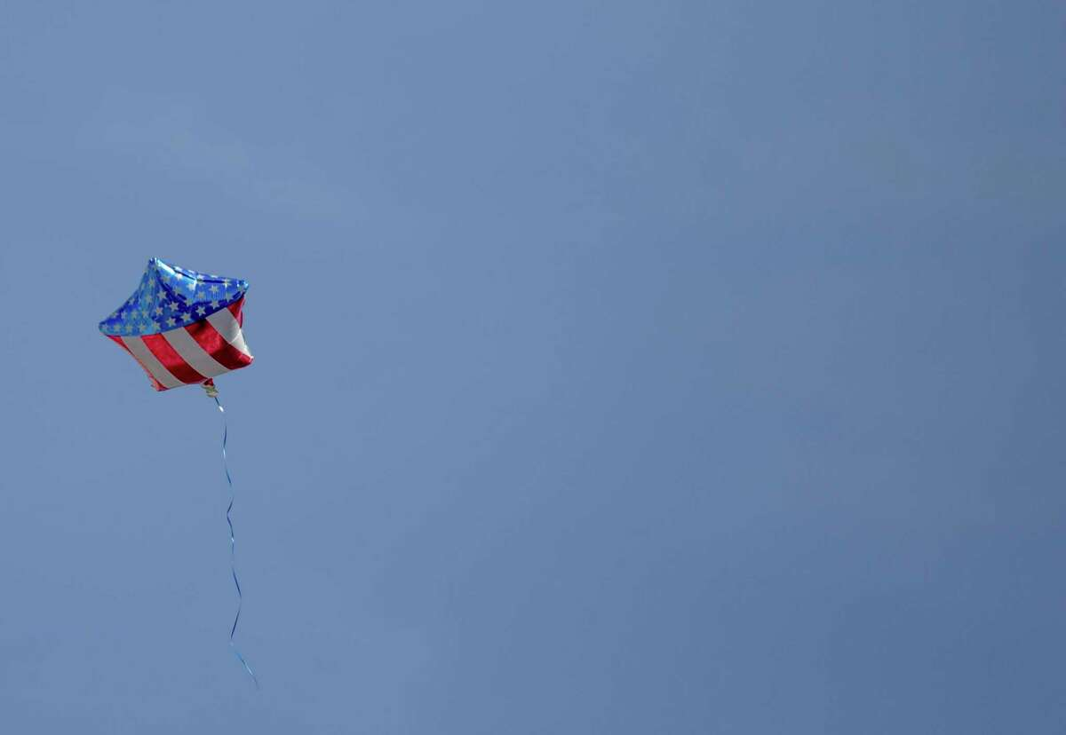 An American flag balloon floats away during a campaign rally for Joe Biden in St. Louis, March 7, 2020. (Brain Munoz/The New York Times)