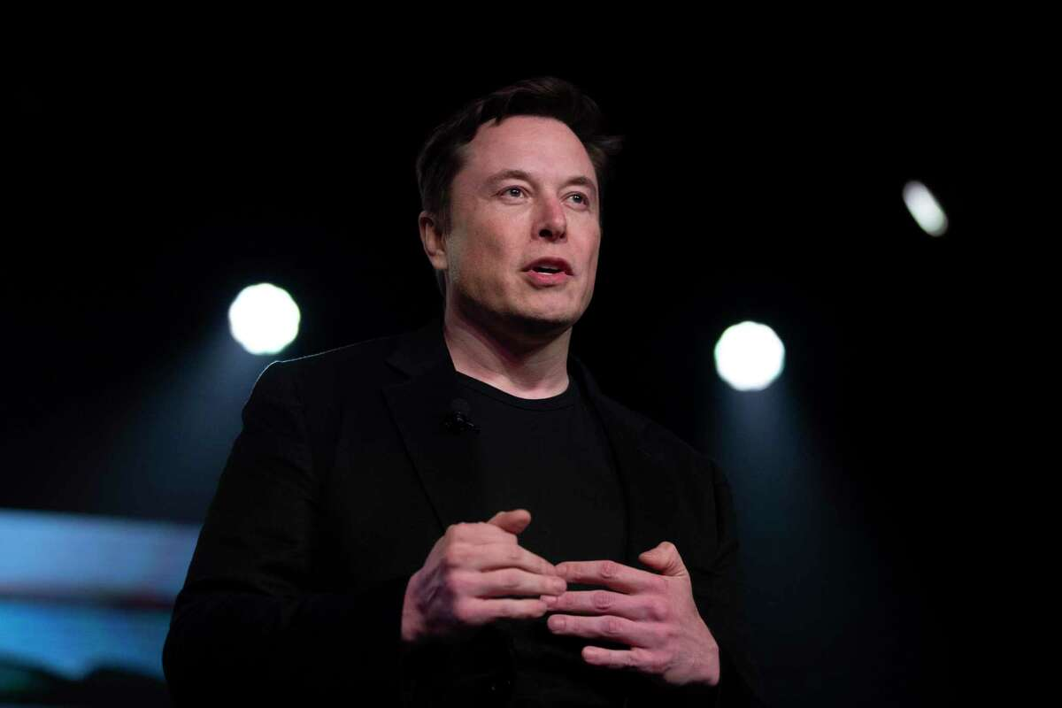 FILE - In this March 14, 2019, file photo, Tesla CEO Elon Musk speaks before unveiling the Model Y at the company's design studio in Hawthorne, Calif. Tesla says it will relocate its headquarters from Palo Alto, Calif., to Austin, Texas, though the electric car maker will keep expanding its manufacturing capacity in the Golden State. Musk gave no timeline for the move late Thursday, Oct. 7, 2021, when he addressed the company's shareholders at Tesla's annual meeting. (AP Photo/Jae C. Hong, File)