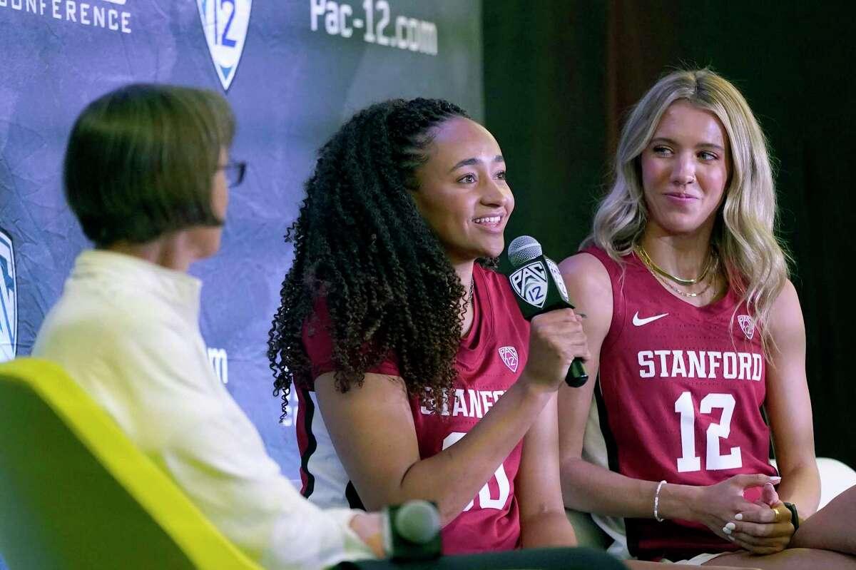 Stanford head coach Tara VanDerveer (left) listens as Haley Jones speaks next to Lexie Hull on Pac-12 Media Day.