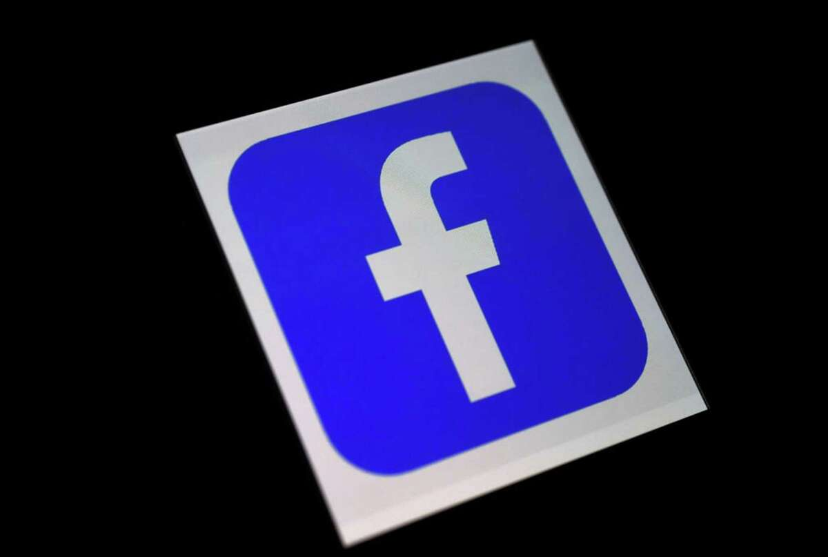 In this photo illustration, a Facebook app logo is displayed on a smartphone. (Olivier Douliery/AFP/Getty Images/TNS)