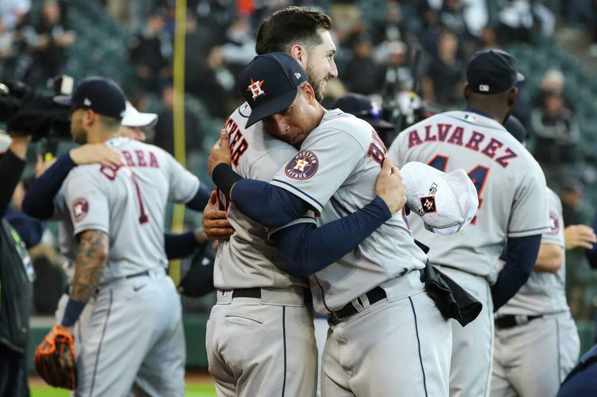 Houston Astros rKyle Tucker (30) and Michael Brantley (23) embrace as they celebrate the Astros 10-1 win over the Chicago White Sox in Game 4 of the American League Division Series Tuesday, Oct. 12, 2021, in Chicago.
