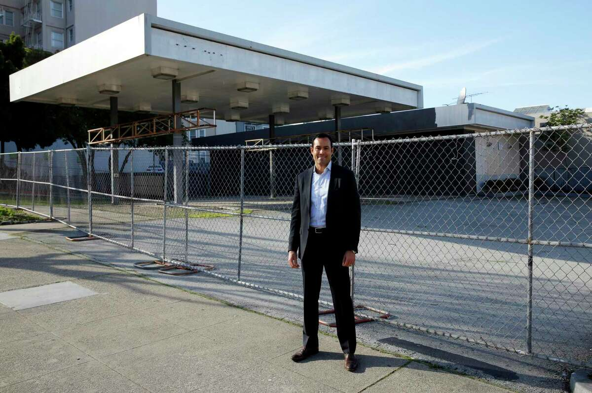 Mark MacDonald, principal at DM Development, visits a boarded-up gas station lot targeted for development in San Francisco. Gas stations have fueling housing projects for years.
