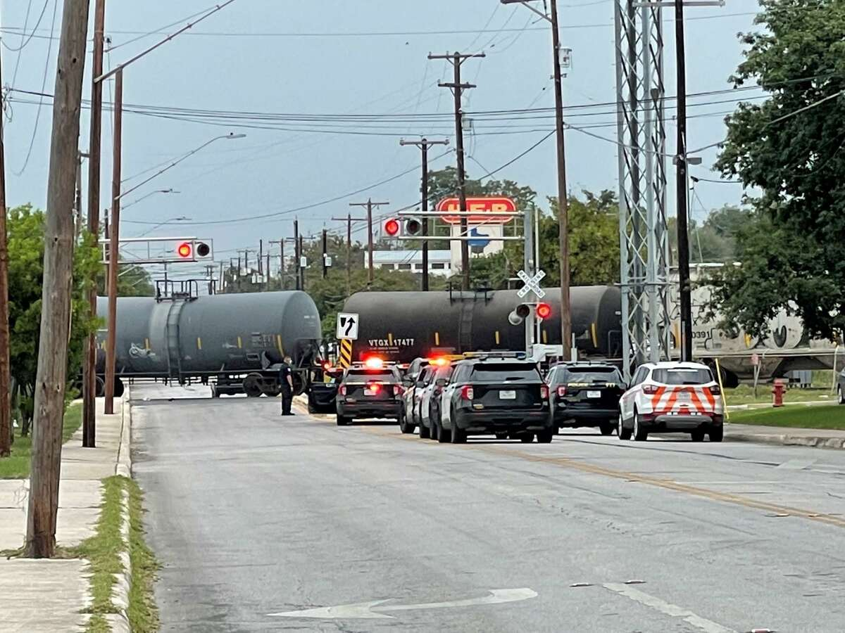 San Antonio police investigate the scene where a man was fatally struck by a train on Oct. 12, 2021, in the 400 block of West Olmos Drive.