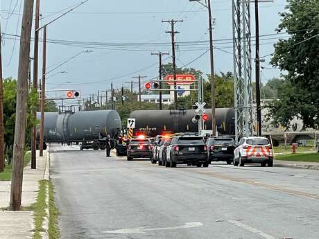 San Antonio police investigate the scene where a man was fatally struck by a train in the afternoon on Oct. 12, 2021, in the 400 block of West Olmos Drive.