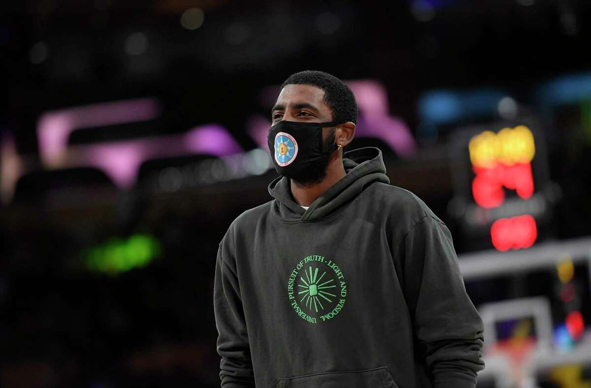 Kyrie Irving (11) of the Brooklyn Nets during a preseason game against the Los Angeles Lakers at Staples Center on Oct. 3, 2021 in Los Angeles. Irving won't play or practice with the Nets until he gets a COVID-19 vaccine shot, the team said. (Kevork Djansezian/Getty Images/TNS)