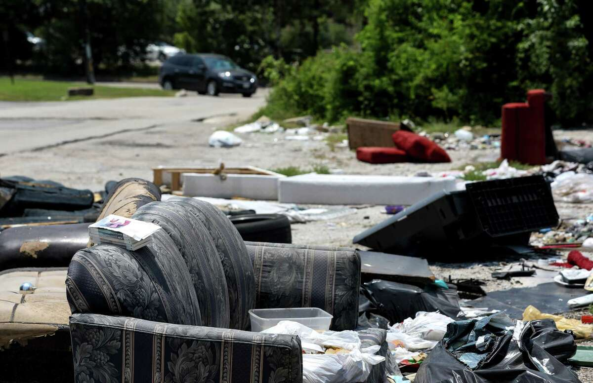 Through targeted enforcement, officials hope to deter people from creating illegal dump sites, like this one near the intersection of West Mount Houston Road and IH-45, photographed Thursday, July 26, 2018, in Houston.