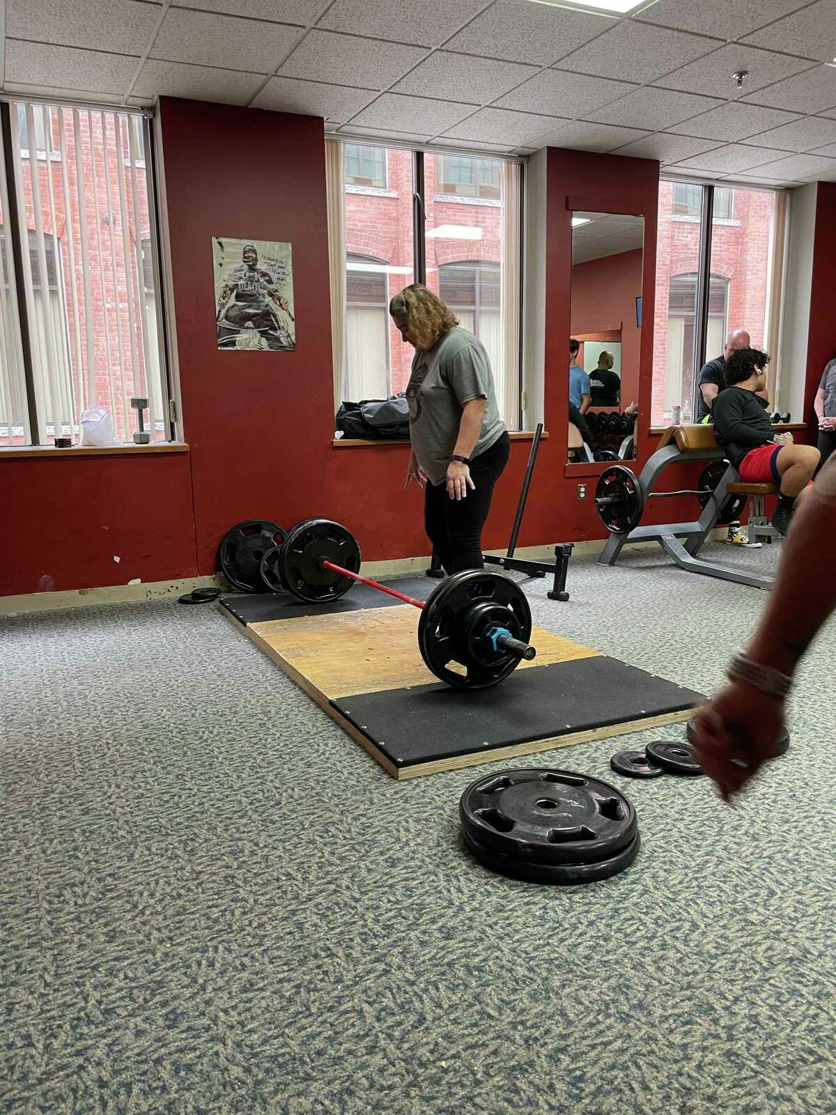 Energy Fitness Factory, 59 Field St., Torrington, launched its fall food drive for FISH with a weight lifting competition. The drive continues through October. Dora Carr was the winner in the women's competition.