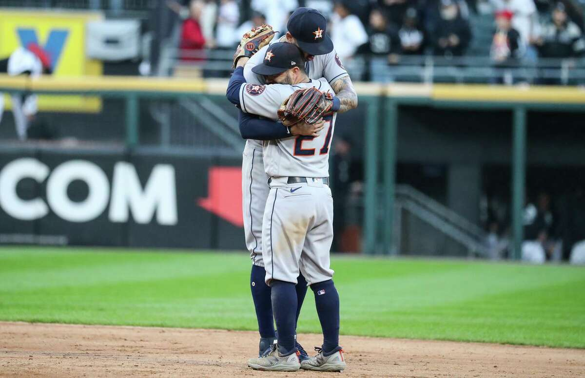 Houston Astros shortstop Carlos Correa and second baseman Jose Altuve (27) celebrate their series-clinching 10-1 win over the Chicago White Sox in Game 4 of the ALDS in Chicago.