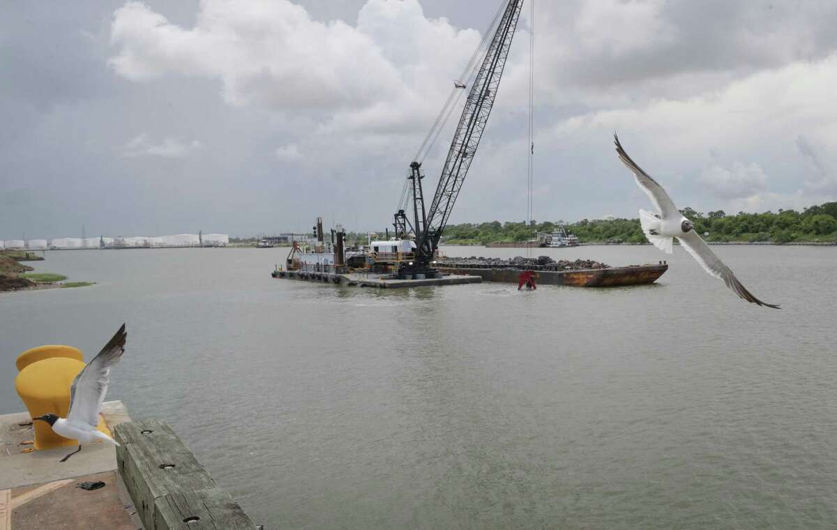 Seagulls take off as a dredge removes sediment on Wednesday, July 14, 2021.
