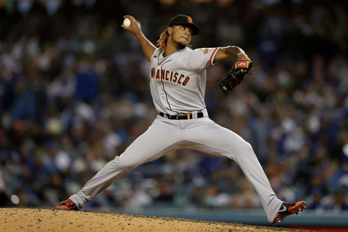 LOS ANGELES, CALIFORNIA - OCTOBER 11: Camilo Doval #75 of the San Francisco Giants pitches against the Los Angeles Dodgers during the eighth inning in game 3 of the National League Division Series at Dodger Stadium on October 11, 2021 in Los Angeles, California. (Photo by Ronald Martinez/Getty Images)