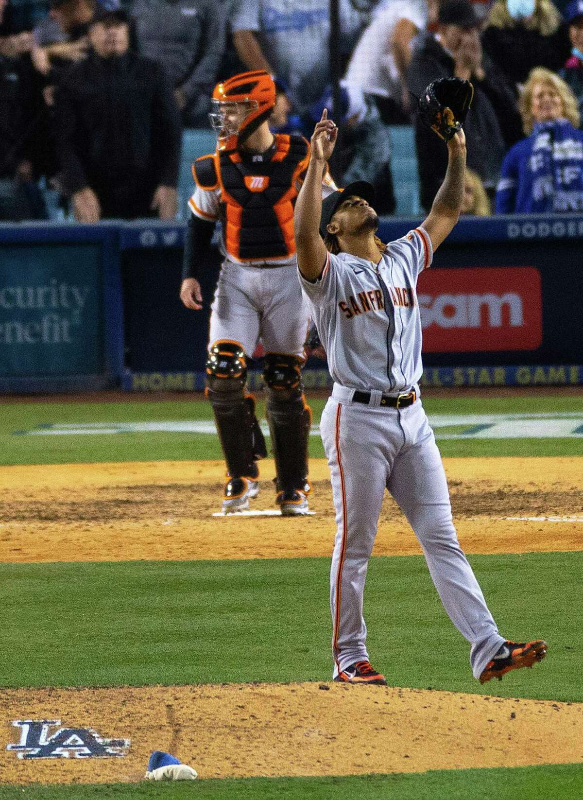 San Francisco Giants closer Camilo Doval (75) points skyward after after the San Francisco Giants defeated the Los Angeles Dodgers 1-0 in Game 3 of the National League Division Series at Dodger Stadium in Los Angeles, Calif. on Monday, Oct. 11, 2021.