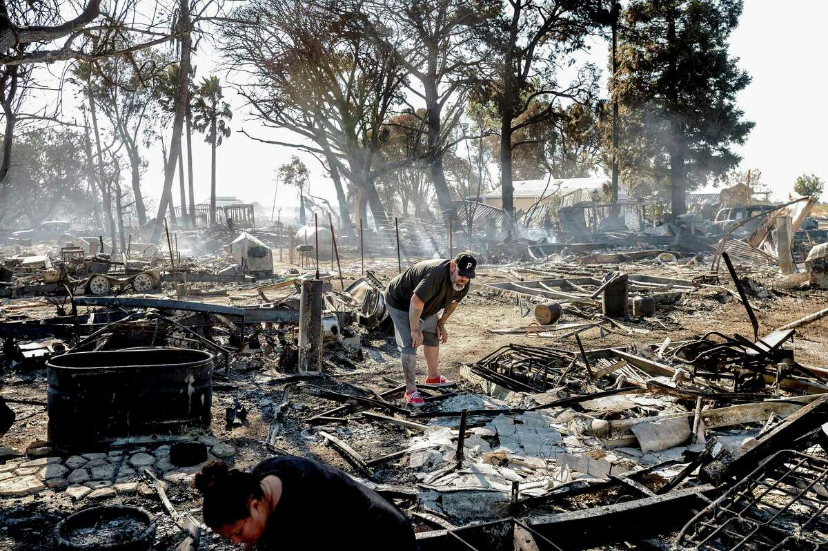 James Grooms looks through the remains of his home at the Rancho Marina RV Park a fire that erupted in the Isleton area of unincorporated Sacramento County swept through the residences.