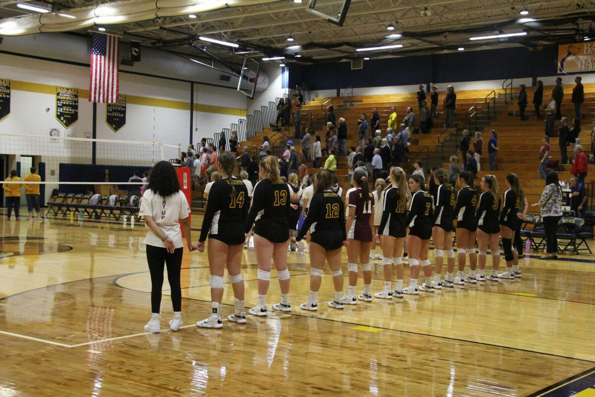 The Lady Rockets line up for the National Anthem.