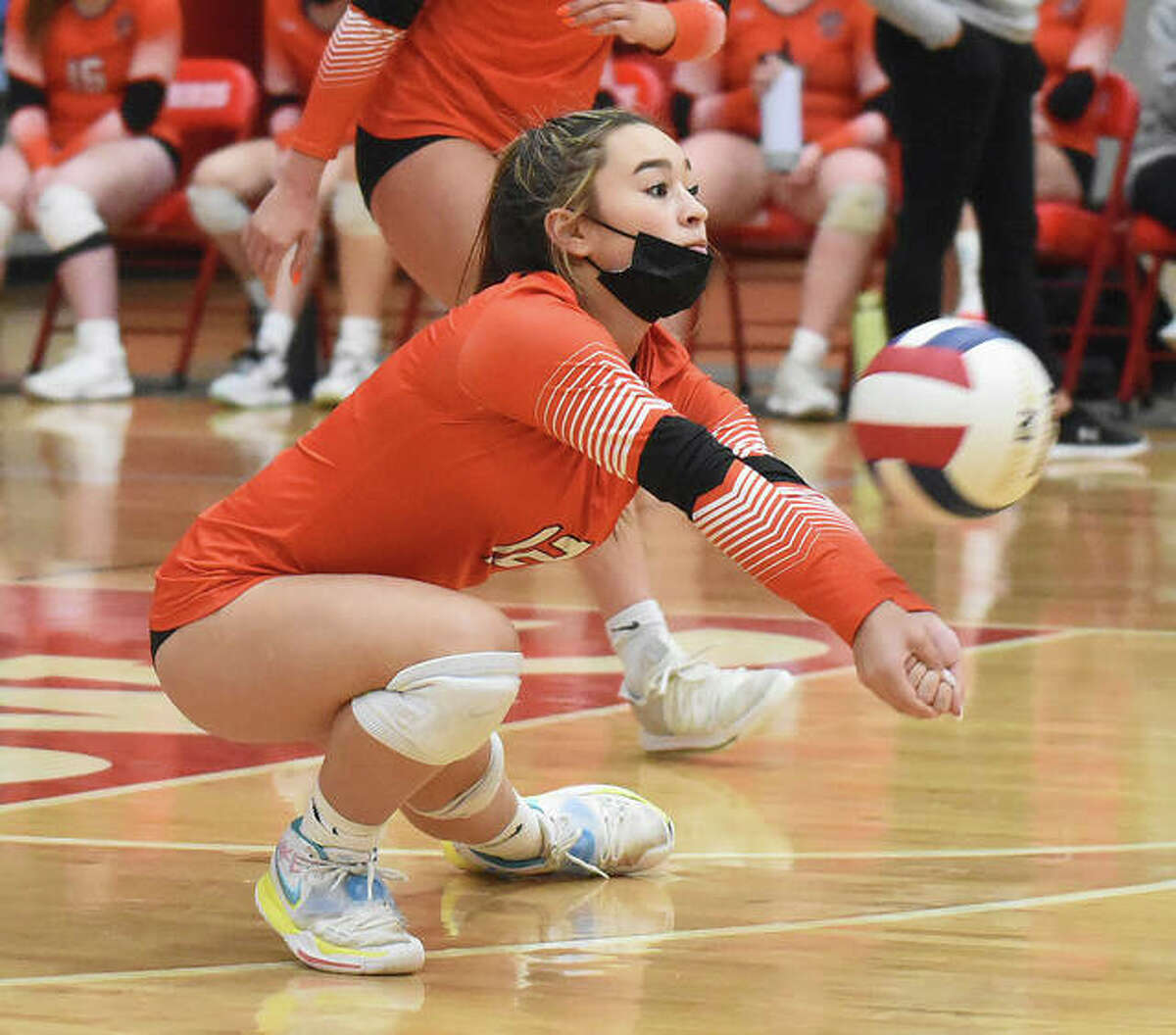 Edwardsville's Hanna Matarelli successfully receives a serve during the second set against the Alton Redbirds on Tuesday in Alton.