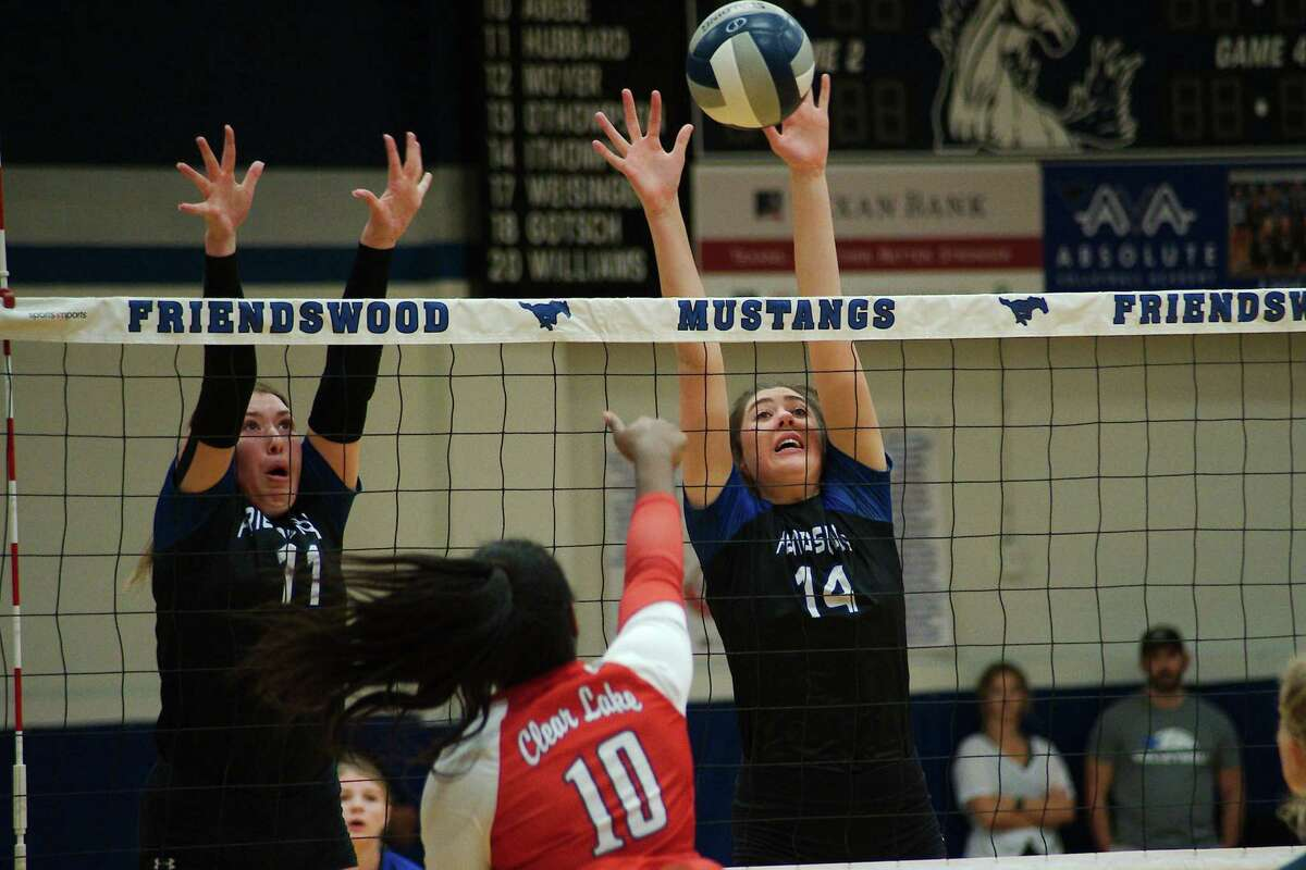Friendswood's Megan Hubbard (11) and Friendswood's Isabella Thompson (14) try to block a shot by Clear Lake's Mia Smith (10) Tuesday, Oct. 12, 2021 at Friendswood High School.