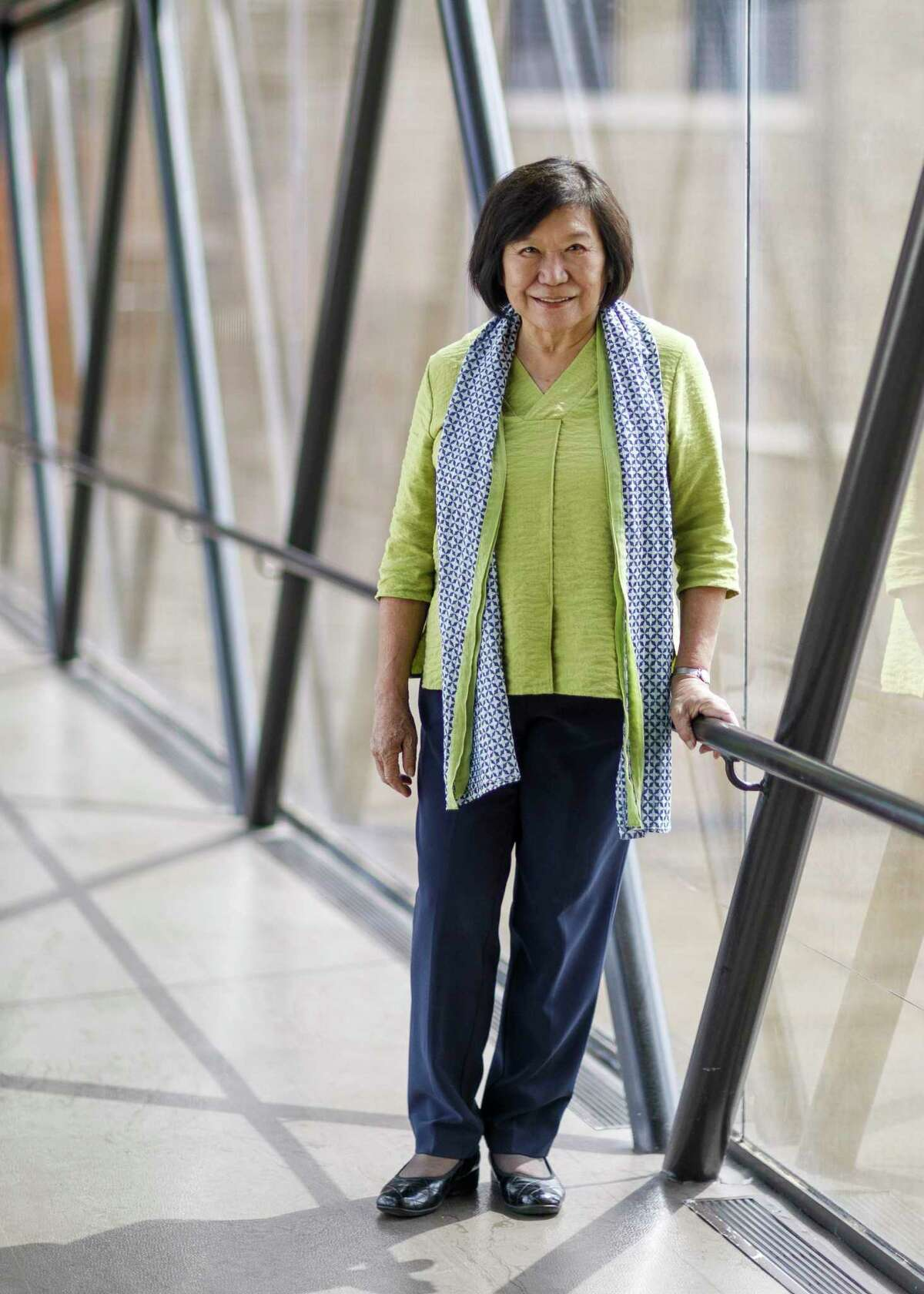 Co-Interim Director Dr. Emily Sano stands in the glass sky bridge that connects parts of San Antonio Museum of Art in San Antonio, Texas, Friday, Oct. 1, 2021. She joined the SAMA staff in January 2016 as the Coates-Cowden-Brown Senior Advisor for Asian Art.