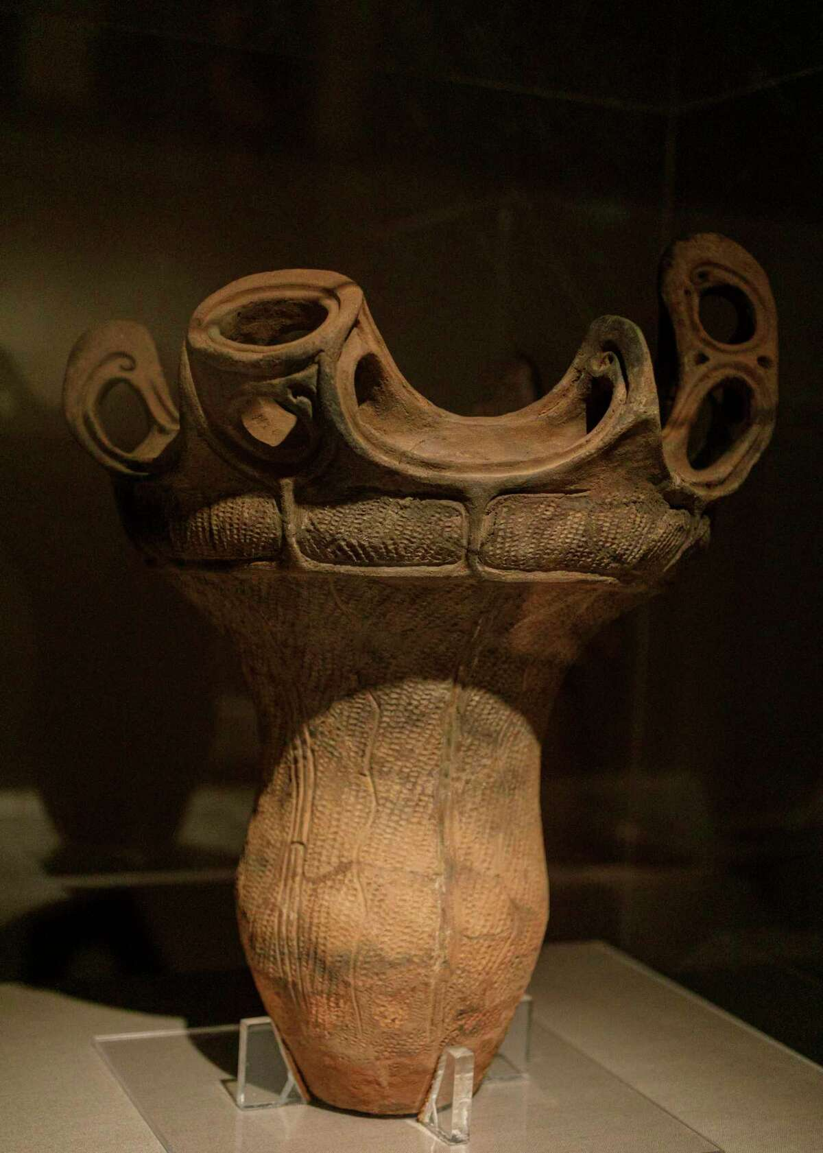 A Japanese earthenware jar from the Jomon Period, 3000-2000 BC, is on display for visitors to look at in the Japanese art gallery at the San Antonio Museum of Art in San Antonio, Texas, Friday, Oct. 1, 2021. The jar was purchased with funds provided by the Lenora and Walter F. Brown Asian Art Challenge Fund.
