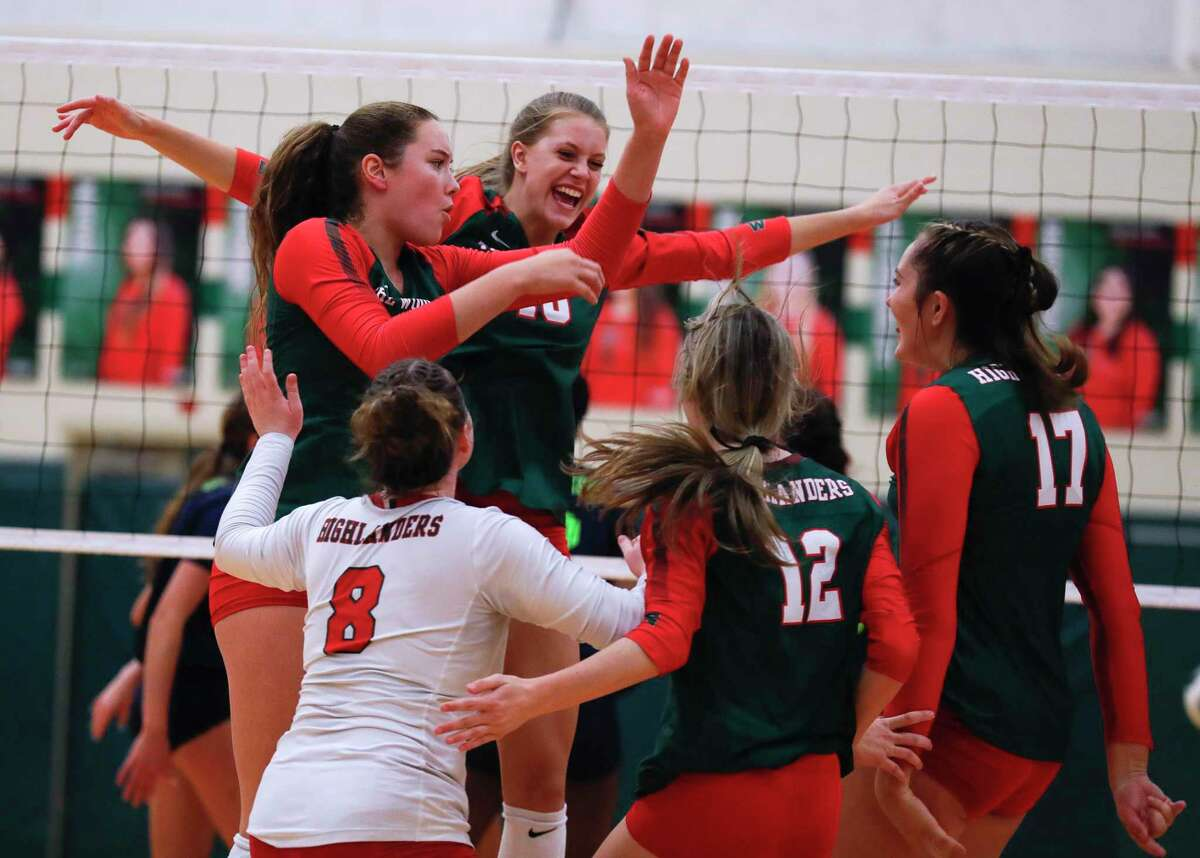 The Woodlands' Lily McWhorter (10) reacts with teammates after a blocked shot during the second set of a high school volleyball match at The Woodlands High School, Tuesday, Oct. 5, 2021, in The Woodlands.